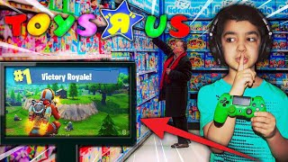 THIS 5 YEAR OLD KID WON A GAME OF FORTNITE IN TOYS R US!   MY LITTLE BROTHER GETS A VICTORY ROYALE