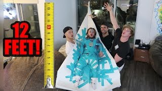 DWARF ATTACHED TO 12-FOOT PAPER AIRPLANE! (will it fly!?)