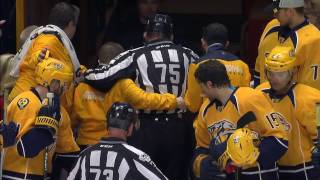 Linesman heads to dressing room after falling awkwardly breaking up fight
