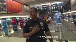 COP  harassing me for not showing my ID and video recorder in a public  airport and calls for backup