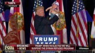 Trump gets baby from crowd