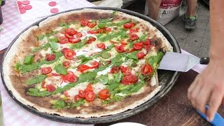 Italy Street Food. Cooking the Focaccia Flat Bread From Genova. Most Colourful and Tasty