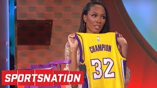 Josh Hart gives Cari Champion some Lakers gear after Marcellus