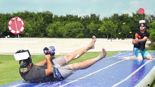 Nerf Slip and Slide Battle   Dude Perfect