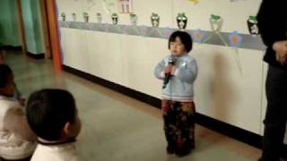 Chinese muslim girl reciting Quran at her preschool