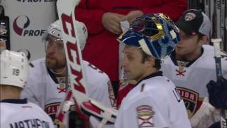 Demers clears puck with his fist after a Luongo goal-line save