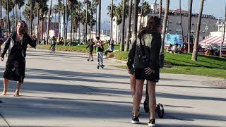 woman gets hit by a skateboard and not happy at venice beach