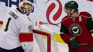 Luongo goes all-in and must recover to make save on Parise