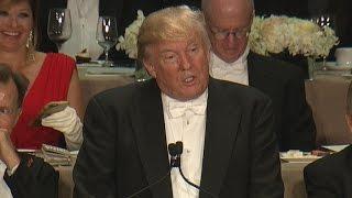 Trump roasts Clinton at Al Smith charity dinner