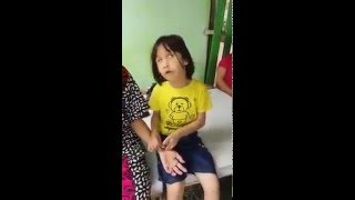 Blind Asian little girl recites the Quran beautifully.