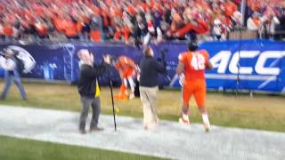 TigerNet.com - Clemson players sing alma mater, throw oranges