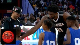 Joel Embiid vs four children from the Jr.NBA