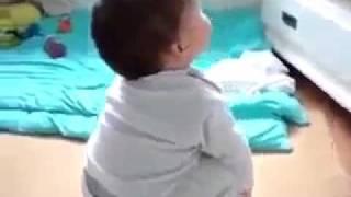 WATCH THE BABY RESPONSE WHEN HE HEARS THE QURAN { ALLAH U AKBAR }