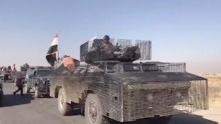 Iraqi forces battle Kurdish peshmerga fighters in Kirkuk