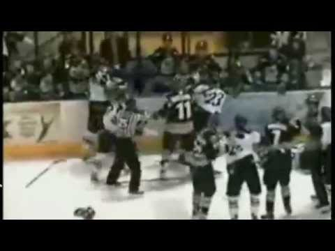 Female hockey player fights 2 boys during the game!