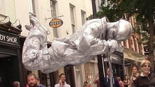 Silver man secret revealed London street performer, floating and levitating trick