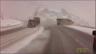 Semi truck sends snow plow over embankment in Utah canyon