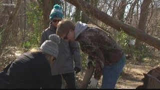 Dozens clean up trash in Riverfront Park