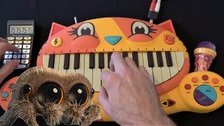 Lucas The Spider - Musical Spider On A Cat Piano and A Drum Calculator