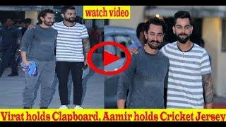 Virat holds Clapboard, Aamir holds Cricket Jersey