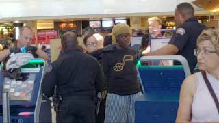 LAX airport police on a 5150 woman she claims she owns Lax and she with FBI
