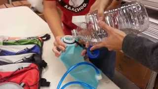 Water bag hydration pack with bladder installation