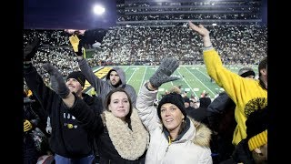 Football fans in Iowa find a way to bring joy to young patients at a nearby hospital