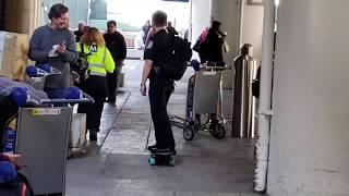 Us customs officer on skateboard at LAX
