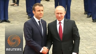 Macron welcomes Putin at France