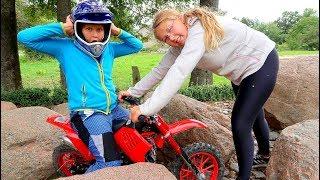 Funny Baby STUCK between STONES Kid Ride on New Dirt Cross Bike Power Wheel