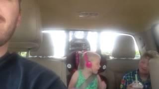 Kid has headphones on talking loud
