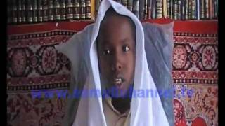 A  young boy cries emotinally while reading  Quran
