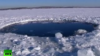 Video: Huge hole as Russian meteor smashes into icy lake