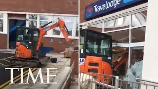 Man Exacts Revenge On A Hotel By Running A Digger Through Lobby | TIME
