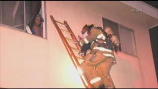 Firefighters Save Baby From Burning Home