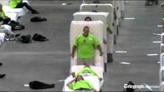 Human mattress dominoes attempt breaks world record