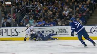 Rielly heads to dressing room after awkward tumble into boards