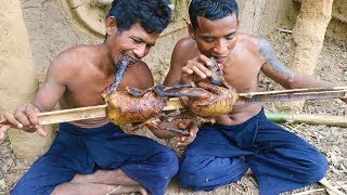 Catch two water duck in river by hand and cook in forest