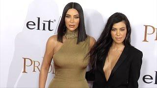 "Kim Kardashian and Kourtney Kardashian ""The Promise"" Premiere Red Carpet"