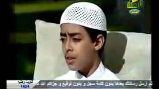 Very, very beautiful voice, a boy reads the Koran