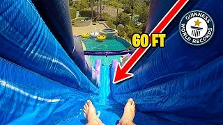*WORLD RECORD* BIGGEST BACKYARD WATER SLIDE EVER!!