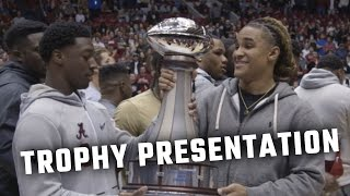 The Alabama football team accepts SEC Championship, Peach Bowl trophies