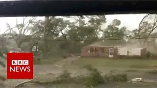 Watch US tornado rip roof from house - BBC News