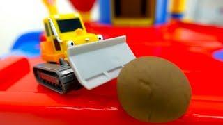 Tolle Spielzeugautos - In unseren Garagen parken tolle Autos - Kipplaster, Bulldozer und Co