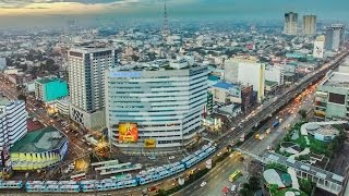 EDSA and North Avenue at dawn in 4K aerial video. EDSA and North Avenue at sunrise.