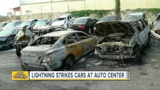 Lightning strike sparks fire and destroying several cars at a Dade City auto repair shop