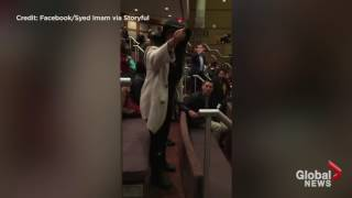 Woman confronts man tearing apart Quran as protesters disrupt school board meeting