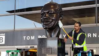 Tom Bradley being cleaned up at LAX