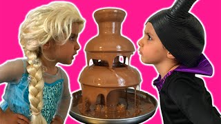 Elsa Vs Maleficent Real Life Disney Princess Movie + CHOCOLATE FOUNTAIN + Candy + 10 Surprise Eggs!