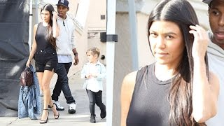 Kourtney Kardashian Flashes Her Legs At Rob